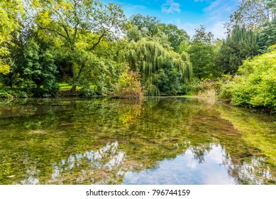 A view of reflections in a lake in Rockingham near Corby, UK in summertime