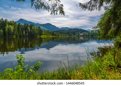 View of reflections in Schwarzsee, Kitzbuhel, Austrian Tyrol, Austria, Europe 1-5-2019