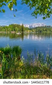 View of reflections of the Wilder Kaiser Mountains in Schwarzsee, Kitzbuhel, Austrian Tyrol, Austria, Europe 1-5-2019