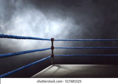 View of a regular boxing ring surrounded by blue ropes spotlit by a spotlight