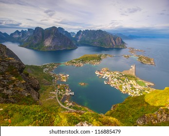 View from Reinebringen on the fishing village Reine at Moskenesoya, Lofoten with the fjord Kjerkfjord in the background.