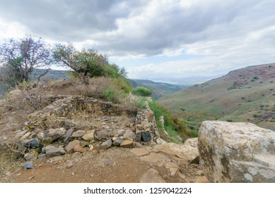 View of the remains of the ancient city and fortress of Gamla, with the Sea of Galilee in the background. Golan Heights, Northern Israel