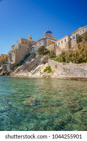 View of a residential area called Vaporia at Ermoupolis town, Syros, Greece. It is an old aristocratic district of Syros island, centered the Greek Orthodox Church of St Nicholaos. Cyclades, Greece