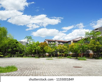 View of a residential area in Tokyo suburb, Japan. Under the blue sky and white clouds.  With a space for copy.