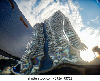 View of residential building distorted by the pool water.