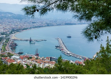 View of the resort town of Alanya, the Lighthouse in the port of Alanya, the old fortress of Alanya, Turkey.