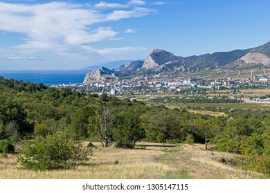 View of the resort town of Sudak from the mountainside. Crimea. Sunny day in September.