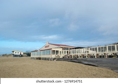 """View of a restaurant called """"Badlust"""" at a beach at Rockanje, Netherlands, during the day"""