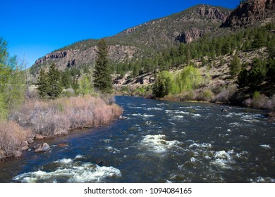 View of the Rio Grande as it flows through the Rocky Mountains along the road to Creede, Colorado in early spring