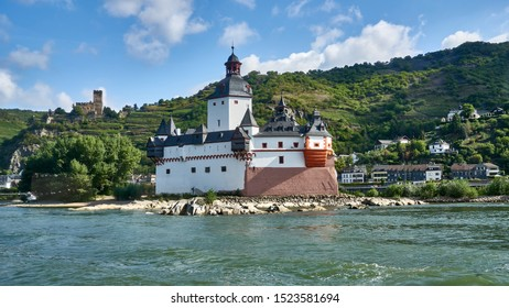 View from the river of the famous tourist attraction, the Pfalzgrafenstein Castle perched on a tiny island in the middle of the Rhine River, near Kaub, Germany - August 2019.