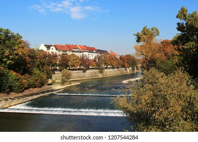 View to the river Isar in Munich, Bavaria, beautiful autumn foliage