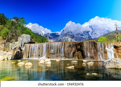 A view of a river and Jade Dragon Snow Mountain in Lijiang (Southwest China).