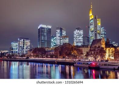 View of River Main and Frankfurt skyline at night. Frankfurt, Hessen, Germany