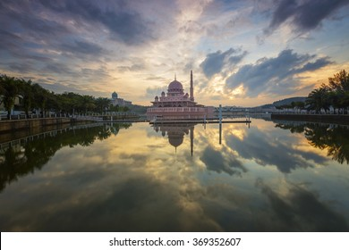 View of river and mosque in Putra Jaya during colorfull sunrise with perfect reflection, Malaysia.soft focus due long exposure