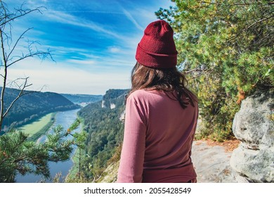 The view. River and mountain. Girl standing on rock looking on national park sachsiche schweiz and czech switzerland and river Labe. The view from Bastei bridge.