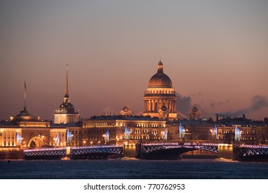 View from the river is not on the main attraction of St. Petersburg St. Isaac's Cathedral. Night illumination of the city on the occasion of the celebration of Christmas and New Year