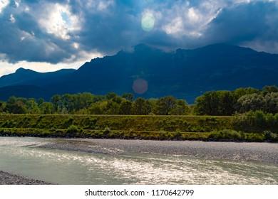 A view of the river Rhine across the international border between Liechtenstein and Swizerland