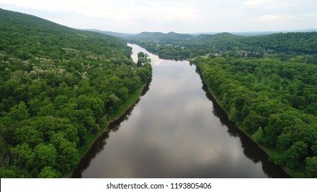 A view of the river surrounded by luscious green trees