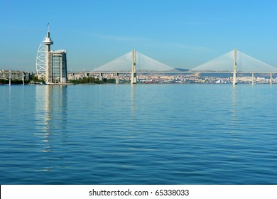 """View from river Tagus of Lisbon's Nations park and """"Vasco da Gama"""" Bridge, Portugal"""