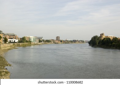 View of the River Thames from Hammersmith Bridge, looking towards Fulham.  The former Harrods furniture depository is on the right hand side and Fulham football ground towards the centre.