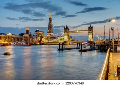 View of the river Thames in London after sunset with the Tower Bridge and the Shard in the back