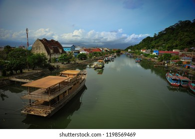 View of rivers and boats from the bridge of Siti Nurbaya Padang, West Sumatra, Indonesia
