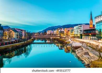 view of a riverside of river Drau during sunset in Villach, Austria