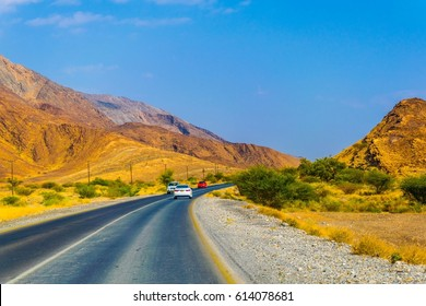 view of a road at the barren environment of Hajar mountains in Oman.