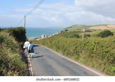 A view of the road down to Portwrinkle in Cornwall, and the sea