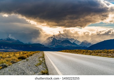 View of the road to El Chalten with Mount Fitz Roy in the mist and  rain clouds in the sky at Argentina Patagonia
