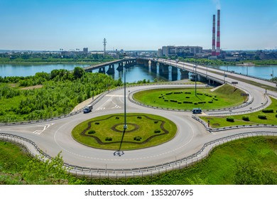 View of the road junction, the bridge and the historic industrial district of Kemerovo from the high right Bank of the Tom river