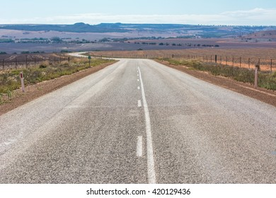 View of Road leading into the distance outback at western Australia