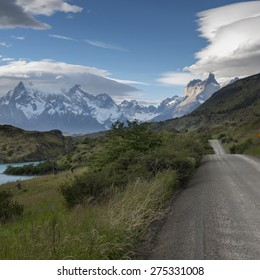 View of road with mountains in the background, Torres del Paine National Park, Patagonia, Chile