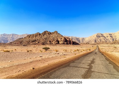 View of a road and rocky panorama in Timna park, Israel
