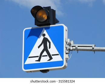 view of road sign pedestrian crossing against blue sky