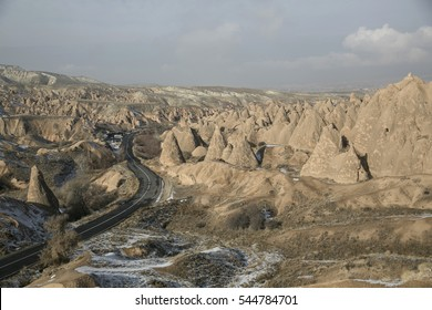 A view of road and snowy chimney in Cappadocia.