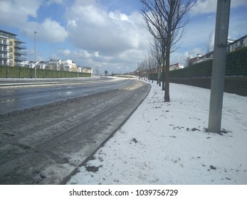 View of the road/roundabout in Ireland during springtime with snow. Irish winter in springtme