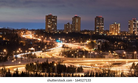 View of roads twisting through a landscape at night