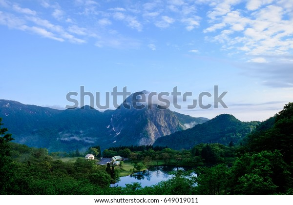View of the rock mountain and pond in the early morning, Mt. Myoujyo and Pond Takanami, Itoigawa City, Niigata Prefecture, Japan