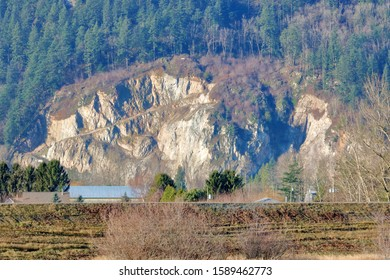 The view of a rockface and the remnants of mining activity that has long since ceased and Mother Nature is now reclaiming.