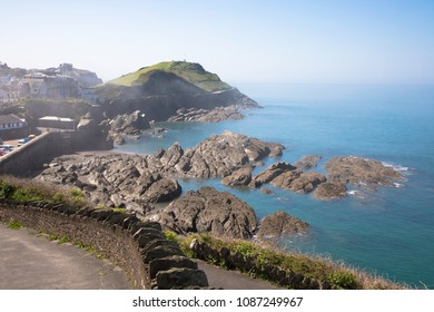 View of the rocks of the coast of Ilfracombe looking towards Capstone Point, Devon, UK