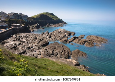 View of the rocks of the coast of Ilfracoumbe looking towards Capstone Point, Devon, UK