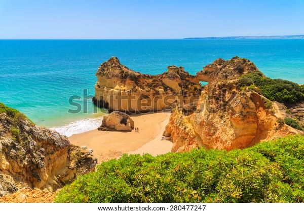 View of rocks on beautiful Alvor beach, Algarve region, Portugal