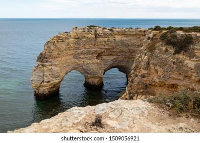 View of rocks on coastline Praia de Marinha, Portugal