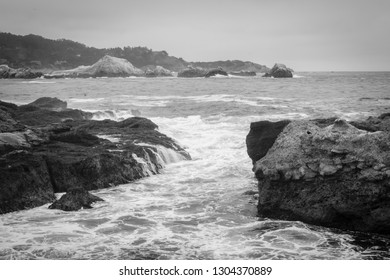 View of rocks and waves in the Pacific Ocean at Point Lobos State Natural Reserve, in Carmel, California.