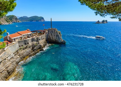 View of the rocky cape in the resort town of Petrovac, Castello Venetian fortress from the XVI century. Sunny day. Montenegro.