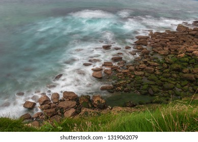View of rocky coast in long exposure. In Cantabria. Spain