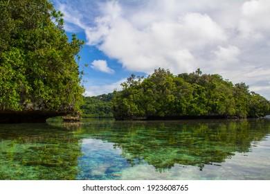 View of rocky hill reflection on Palau Island, Micronesia.