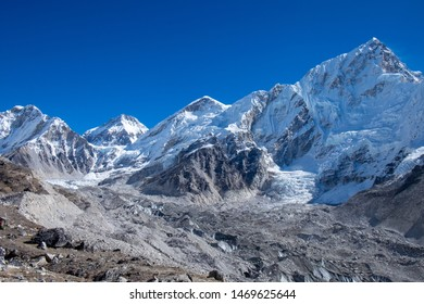 View of rocky Himalaya mountain range covered by white snow and glacier under a deep blue sky, on the way to Kala Phattar, Everest base camp trekking trail, Gorak Shep, Sagarmatha National Park, Nepal