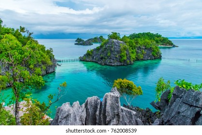 the view of rocky islands, cliffs and lagoon at Kimaboe Hills and Lagoon, Labengki, Southeast Sulawesi, North Konawe, Indonesia, with clear and bright sea water, clear blue sky and clouds